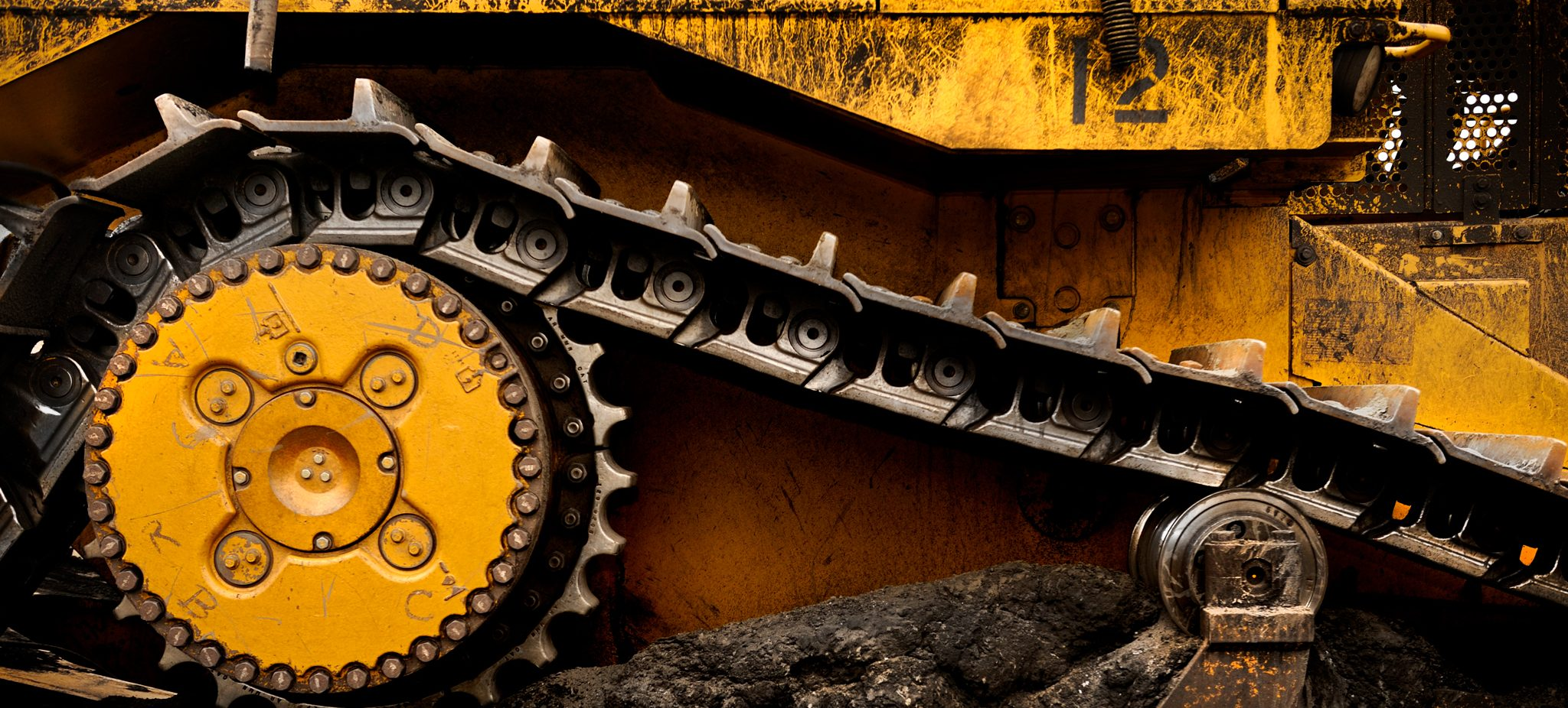 Heavy machinery moving on top of coal